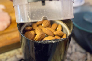 Almonds in a grinder
