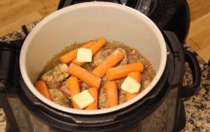 Ninja Foodi Chicken & Wild Rice carrots on top