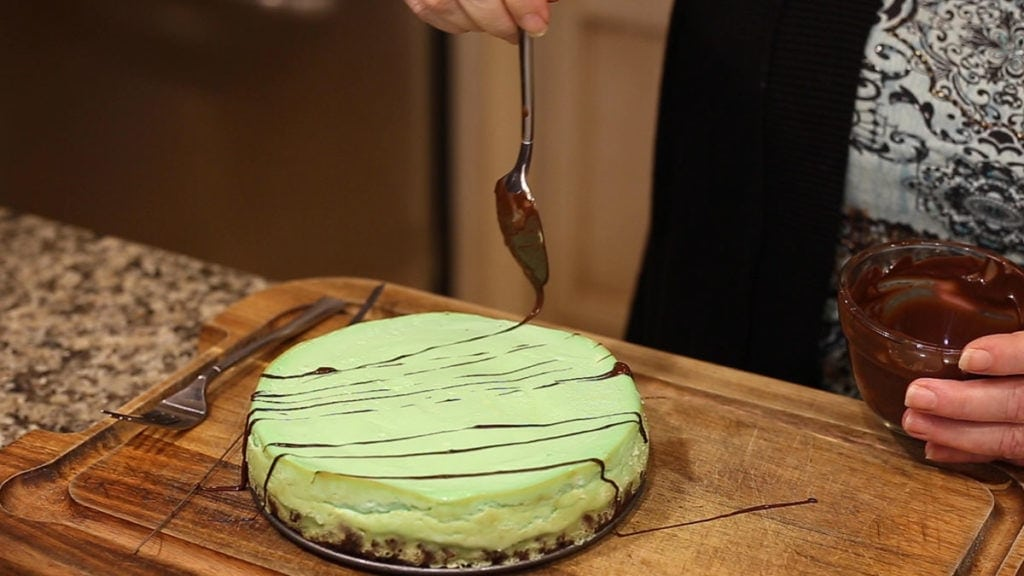 Mint Chocolate Cheesecake in the Ninja Foodi decorating with chocolate