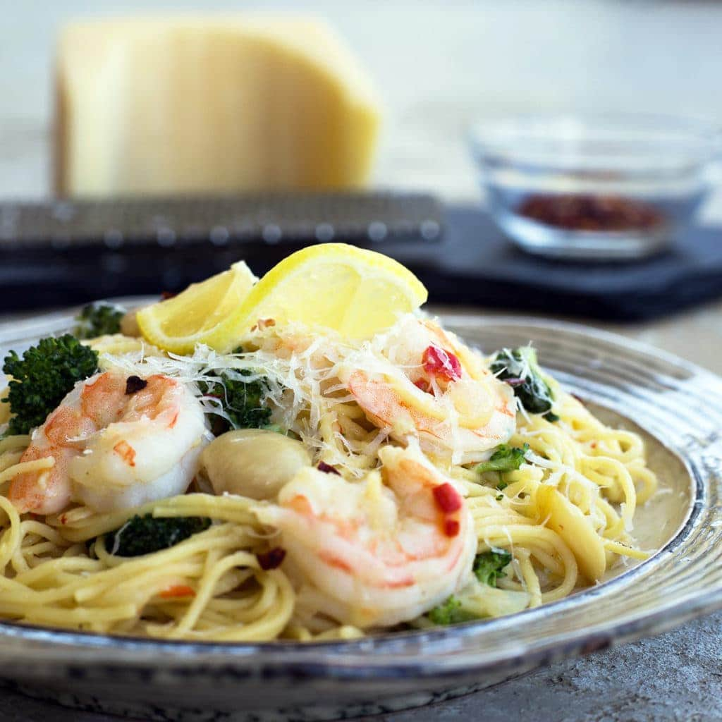 Easy Shrimp Scampi on a plate with a lemon wedge on top