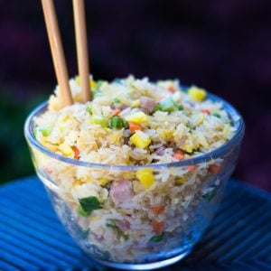 Hawaiian Fried Rice in a glass bowl with chopsticks
