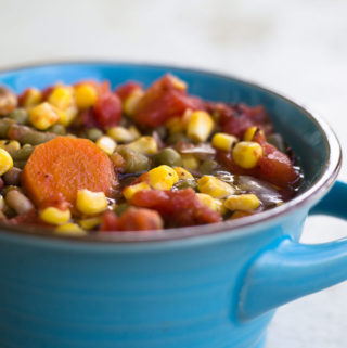 Pressure Cooker Vegetable Soup in a blue bowl
