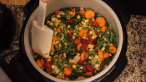 Stirring the ingredients for Pressure Cooker Vegetable Soup