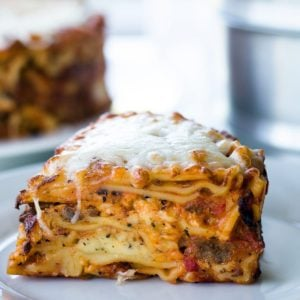 Slice of Lasagna on a white plate
