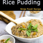 Jasmine Rice Pudding in a bowl garnished with thai basil