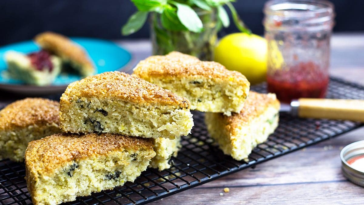 Lemon Basil Scones stacked on a cooling rack