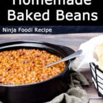 Pressure Cooker Baked Beans in a black pot with a spoon