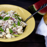Roasted Cauliflower Salad in a yellow bowl