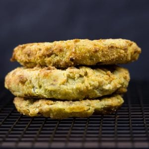 three fried green tomatoes on a cooling rack