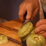 slicing a green tomato