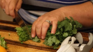 cutting the stems into pieces for carne asada street tacos
