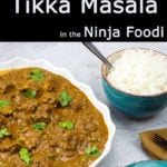 chicken tikka masala in a serving bowl with a bowl of rice