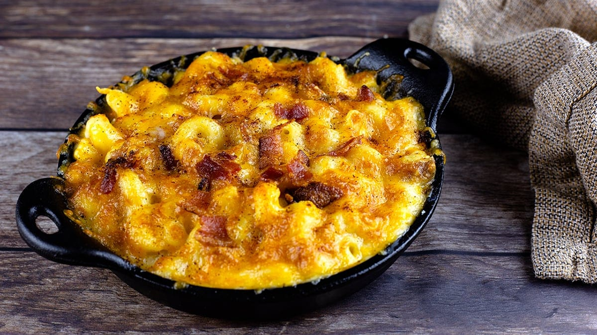 bacon mac and cheese in a cast iron pan