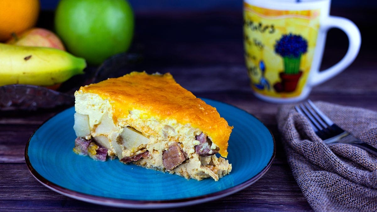 slice of overnight breakfast casserole on a blue plate