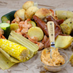 Cajun Shrimp Boil on brown paper with cajun butter