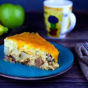 Overnight breakfast casserole on a blue plate