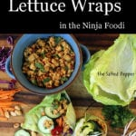 Asian lettuce wraps with toppings on a cutting board