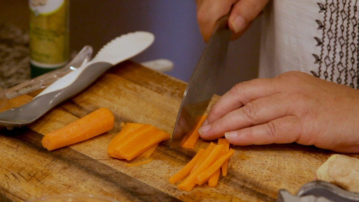 cutting carrots into matchsticks
