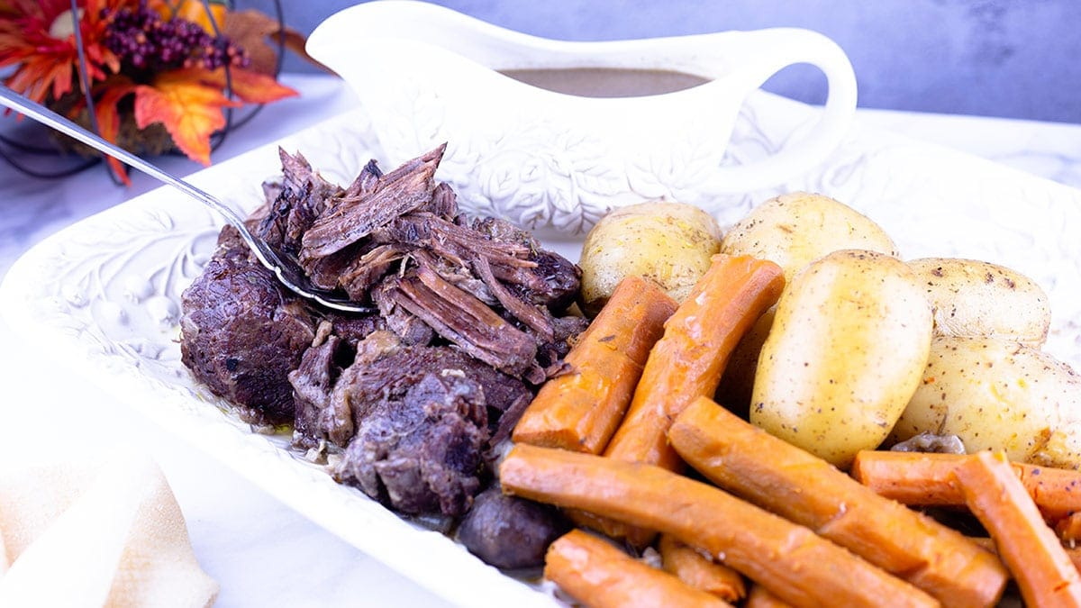 Quick and easy pot roast on a white platter