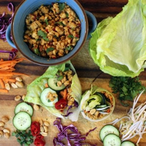 Asian lettuce wraps on cutting board with toppings