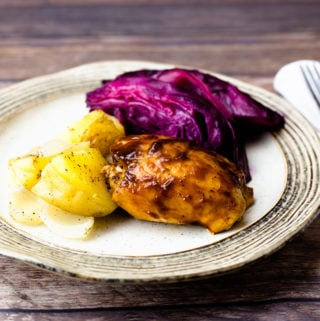 BBQ Chicken, potatoes, purple cabbage on a plate