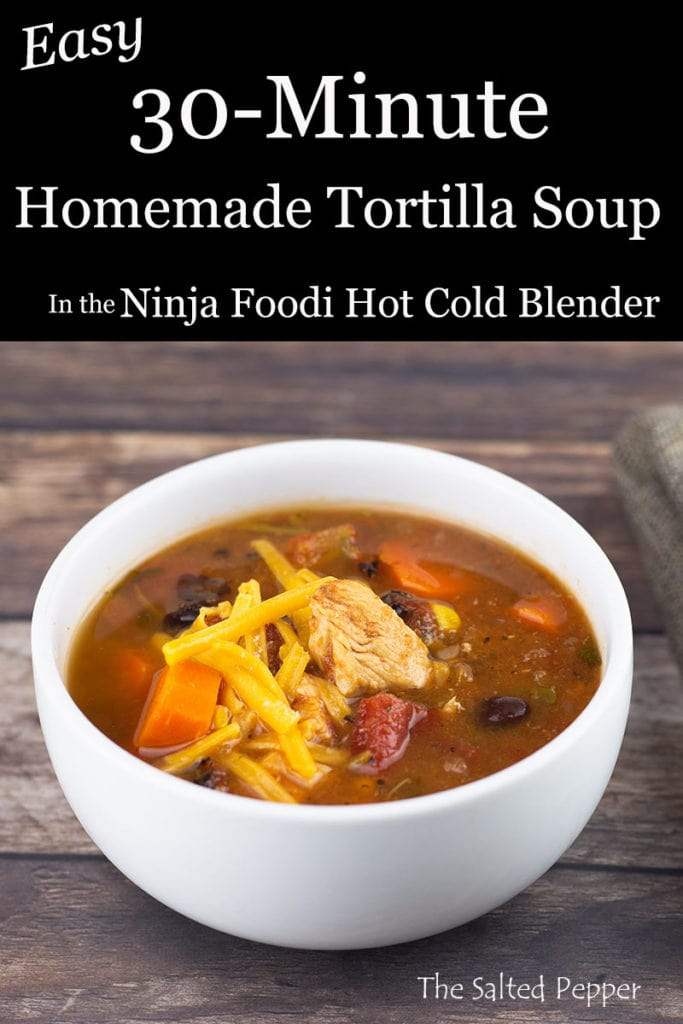 chicken tortilla soup in a white bowl with cheese