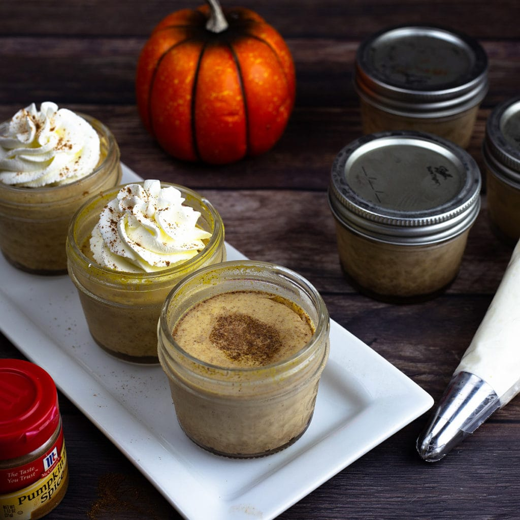 pumpkin pie custard decorated with whipped cream