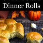 Sweet potato rolls on a cooling rack with one pulled out