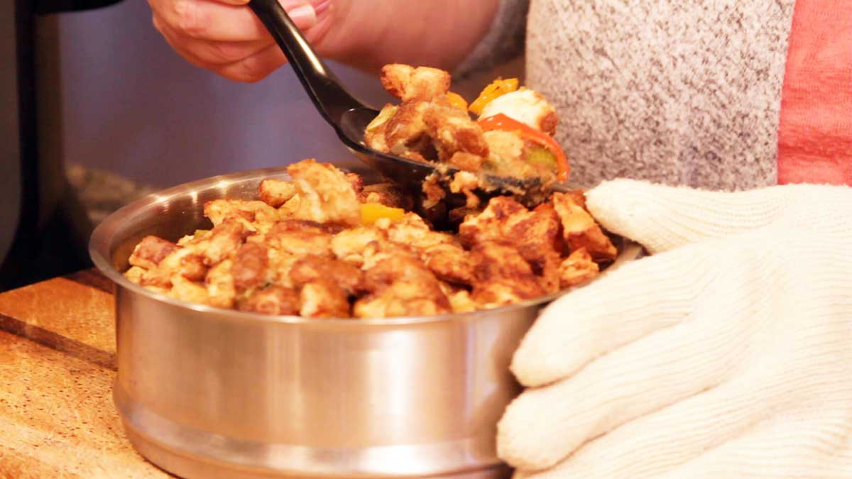 scooping stuffing out of a pan