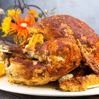 whole turkey sitting on a platter