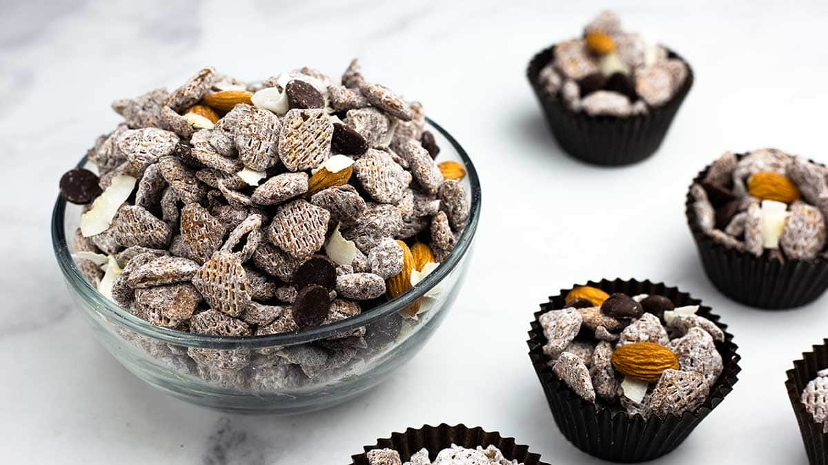 Almond Joy cereal snack mix in a bowl and in cupcake liners