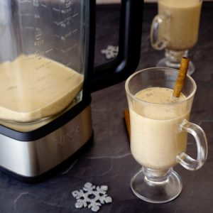 Eggnog in the Hot Cold Blender and a glass of eggnog with a cinnamon stick