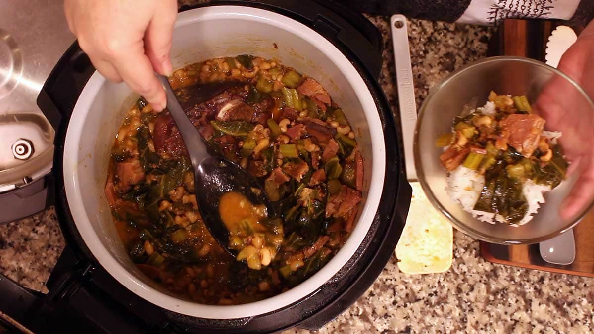 Scooping out the Hoppin John and serving over rice