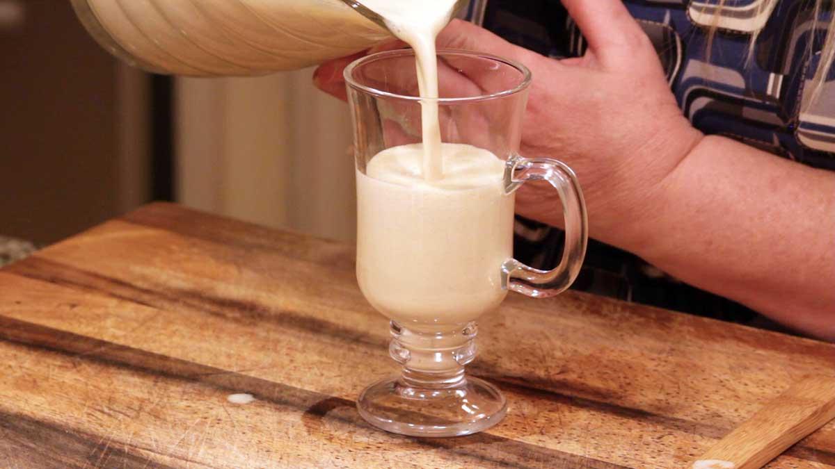 Pouring eggnog into a glass