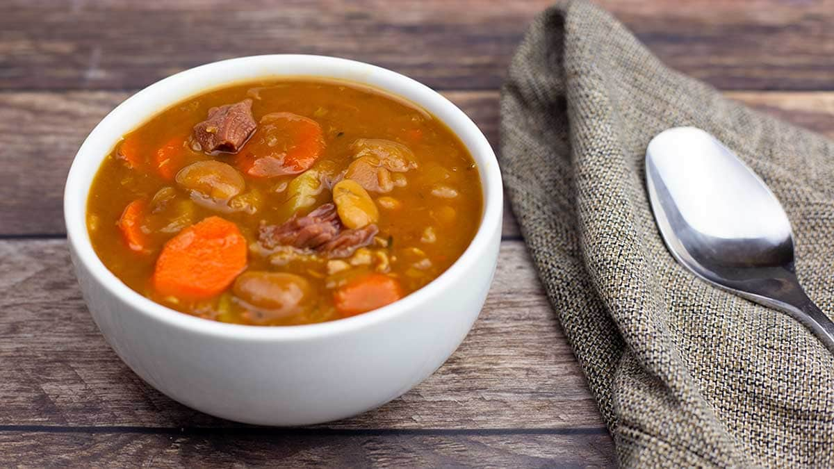 Ham & Lima Bean soup in a white bowl