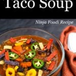Pressure Cooker Taco Soup in a glass bowl with toppings