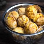 hushpuppies sitting in a metal basket with holes