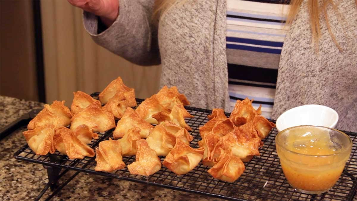 air fryer crab rangoon cooling on a cooling rack