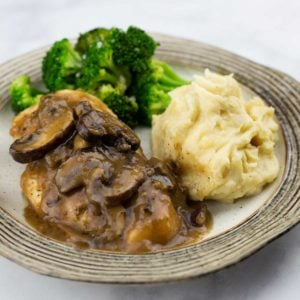 Chicken Marsala with mashed potatoes and broccoli on a plate