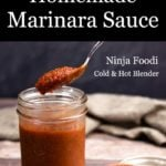 Homemade Marinara Sauce with a spoonful being taken out