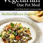 Mediterranean Quinoa with Vegetables on a plate with garnish