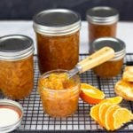 Orange Marmalade in jars with one open and biscuits beside it