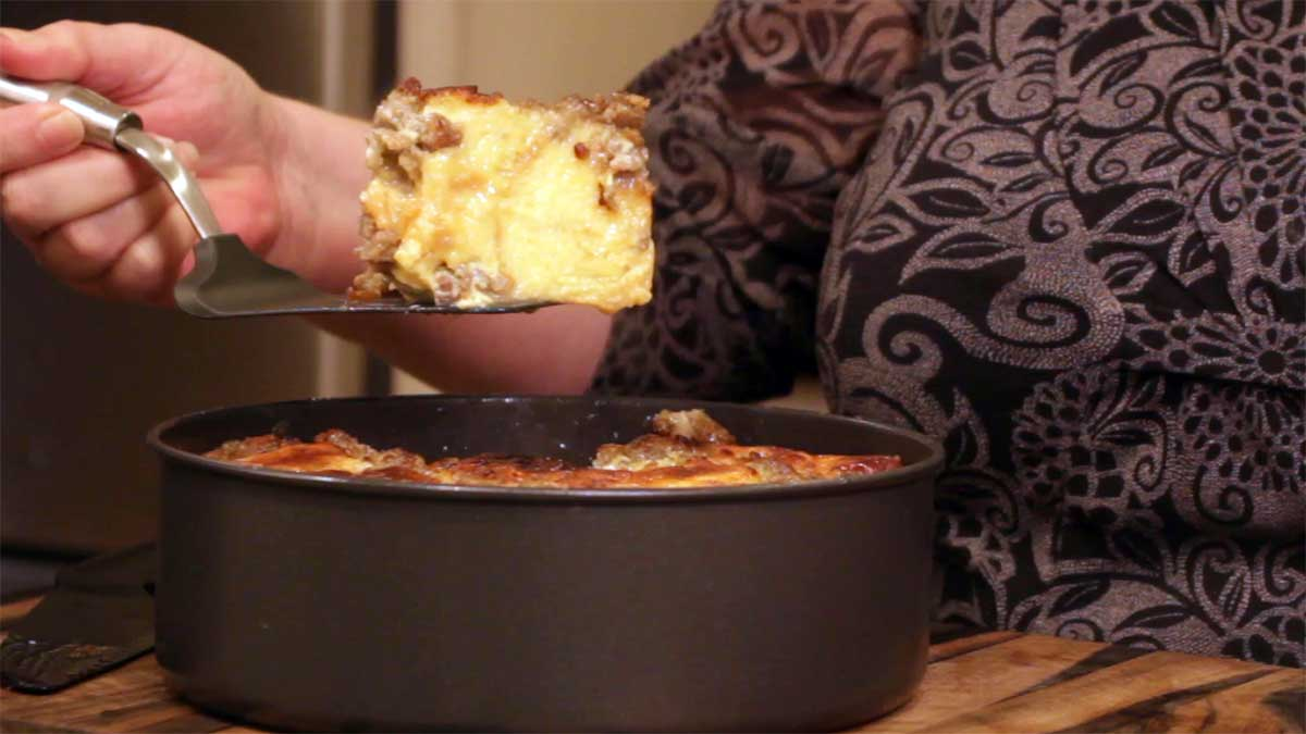 Scooping out a piece of breakfast bread pudding to serve