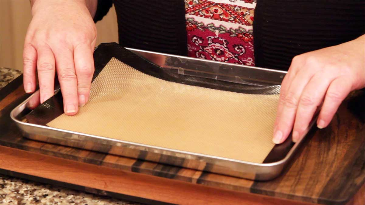 lining baking sheet with silicone mat for brownies