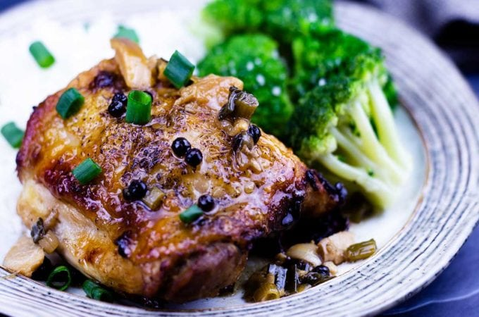 chicken adobo on a plate with broccoli and rice
