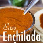 Enchilada Sauce in a glass bowl beside corn tortillas