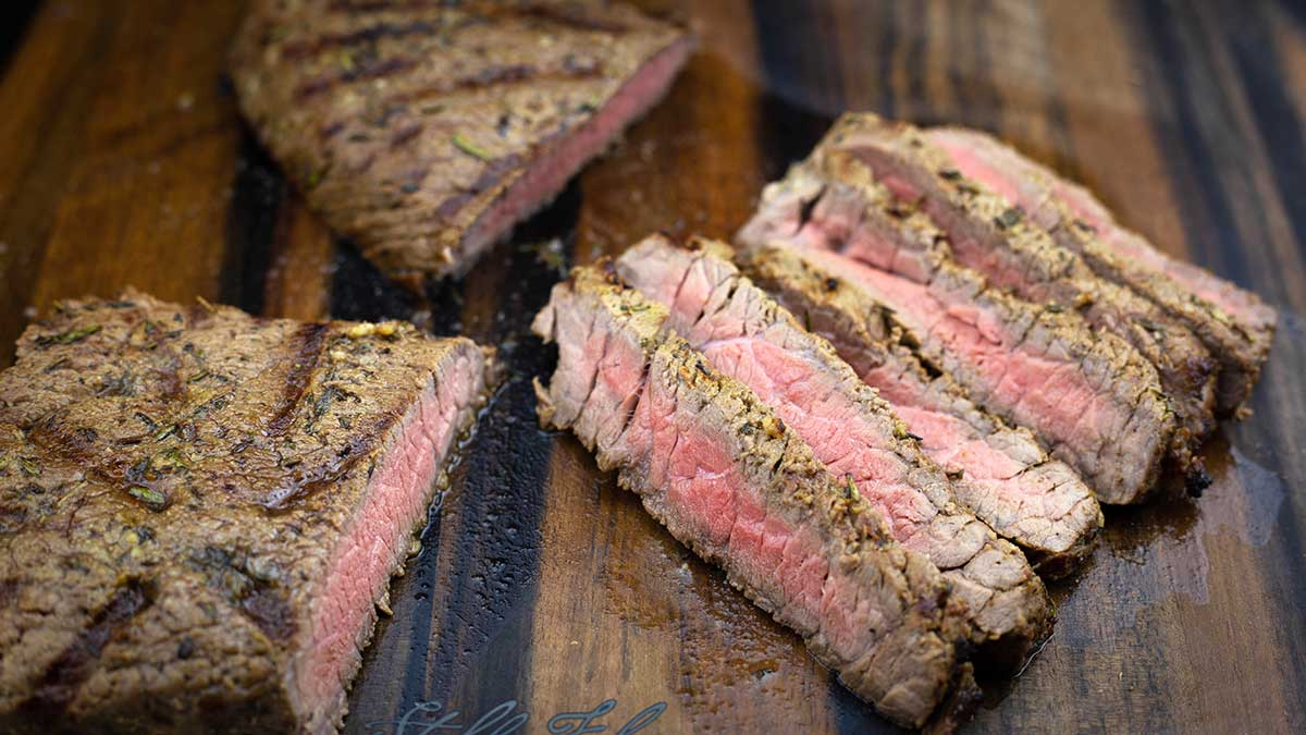 Grilled London Broil Medium Rare sliced on a cutting board