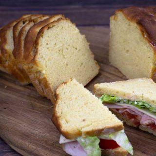 Sliced bread with a Ham & Swiss Sandwich on a cutting board