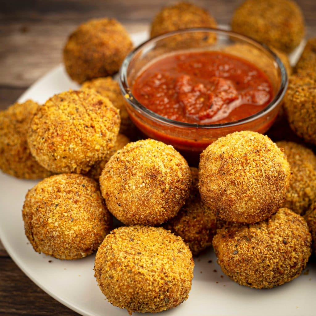 Cauliflower Arancini balls on a plate with marinara