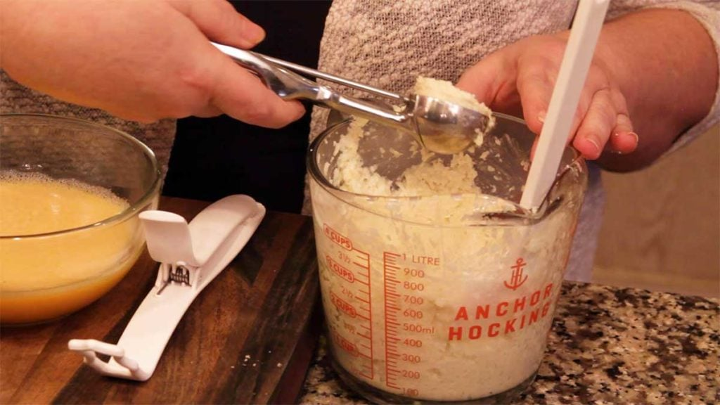 scooping out the cauliflower mixture to form the arancini balls
